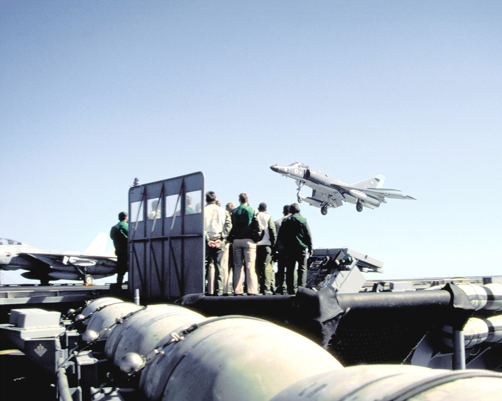 A Super Etendard aircraft of the Argentine Navy passes the landing signal officers station as it prepares to briefly touch down on the flight deck of the nuclear-powered aircraft carrier USS ABRAHAM LINCOLN (CVN-72). The plane is taking part in touch-and-go landings aboard the LINCOLN during the vessel's circumnavigation of South America