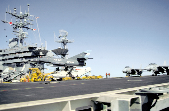 A Super Etendard aircraft of the Argentine Navy prepares to briefly touch down on the flight deck of the nuclear-powered aircraft carrier USS ABRAHAM LINCOLN (CVN-72). The plane is taking part in touch-and-go landings aboard the LINCOLN during the vessel's circumnavigation of South America