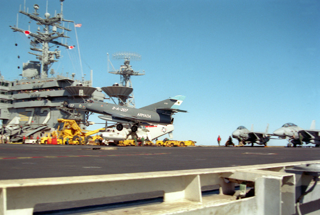A Super Etendard aircraft of the Argentine navy prepares to touch down on the flight deck of the nuclear-powered aircraft carrier USS ABRAHAM LINCOLN (CVN-72). The plane is taking part in touch-and-go landings aboard the LINCOLN during the vessel's circumnavigation of South America