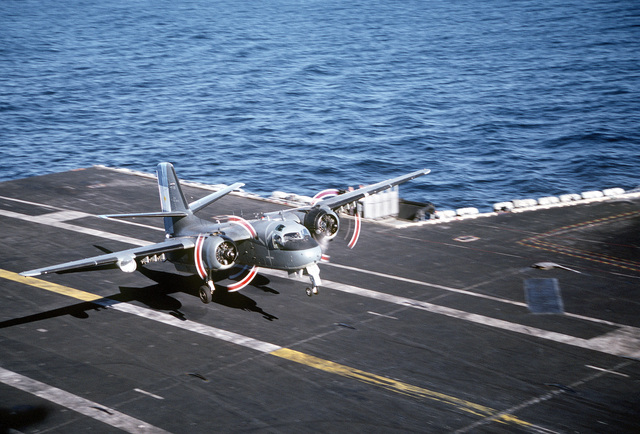 An Argentine navy S-2E Tracker aircraft lands on the nuclear-powered aircraft carrier USS ABRAHAM LINCOLN (CVN-72). The aircraft is taking part in touch-and-go operations aboard the LINCOLN during the ship's circumnavigation of South America