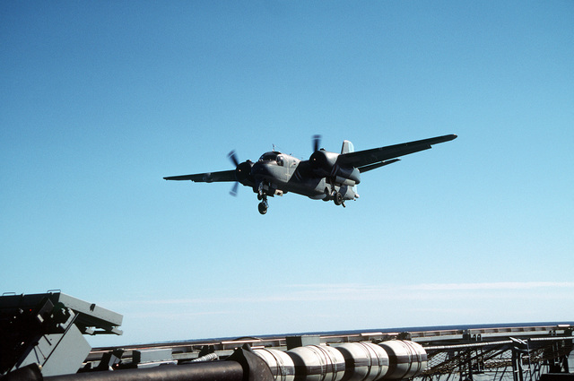 An Argentine navy S-2E Tracker aircraft prepares to land on the nuclear-powered aircraft carrier USS ABRAHAM LINCOLN (CVN-72). The aircraft is taking part in touch-and-go operations aboard the LINCOLN during the ship's circumnavigation of South America