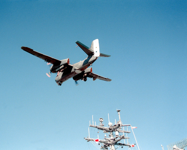 An S-2 Tracker aircraft of the Argentine navy passes over the nuclear-powered aircraft carrier USS ABRAHAM LINCOLN (CVN-72) after being waved off from landing on the vessel's flight deck. The plane is taking part in touch-and-go landings aboard the LINCOLN during the vessel's circumnavigation of South America