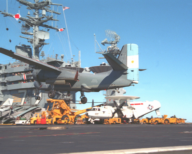 An S-2 Tracker aircraft of the Argentine navy prepares to briefly touch down on the flight deckk of the nuclear-powered aircraft carrier USS ABRAHAM LINCOLN (CVN-27). The plane is taking part in touch-and-go landings aboard the LINCOLN during the vessel's circumnavigation of South America