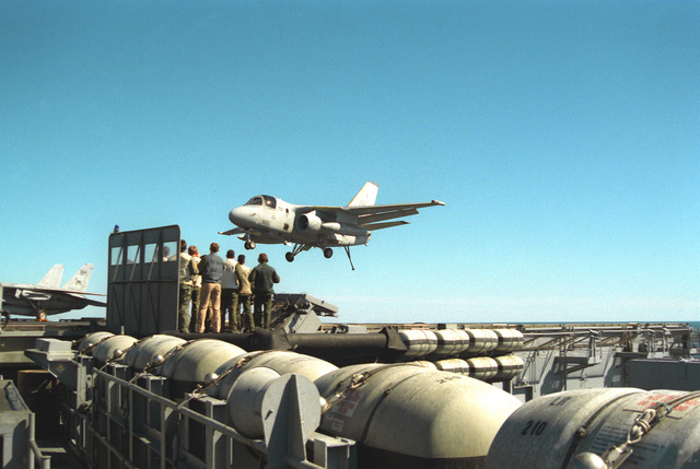 Landing signal officers stand by as an Air Anti-submarine Squadron 29 (VS-29) S-3A Viking aircraft prepares to catch the arresting wire on the flight deck of the nuclear-powered aircraft carrier USS ABRAHAM LINCOLN (CVN-72) during the vessel's circumnavigation of South America