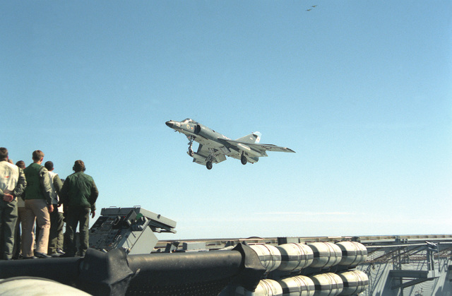 Landing signal officers watch as a Super Etendard aircraft of the Argentine navy approaches the flight deck of the nuclear-powered aircraft carrier USS ABRAHAM LINCOLN (CVN-72). The plane is taking part in touch-and-go landings aboard the LINCOLN during the vessel's circumnavigation of South America
