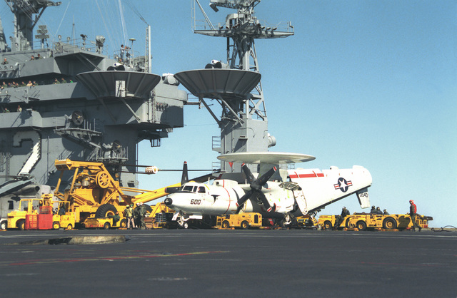Yellow gear surrounds a Carrier Airborne Early Warning Squadron 117 (VAW-117) E-2C Hawkeye aircraft parked on the flight deck of the nuclear-powered aircraft carrier USS ABRAHAM LINCOLN (CVN-72) during the vessel's circumnavigation of South America