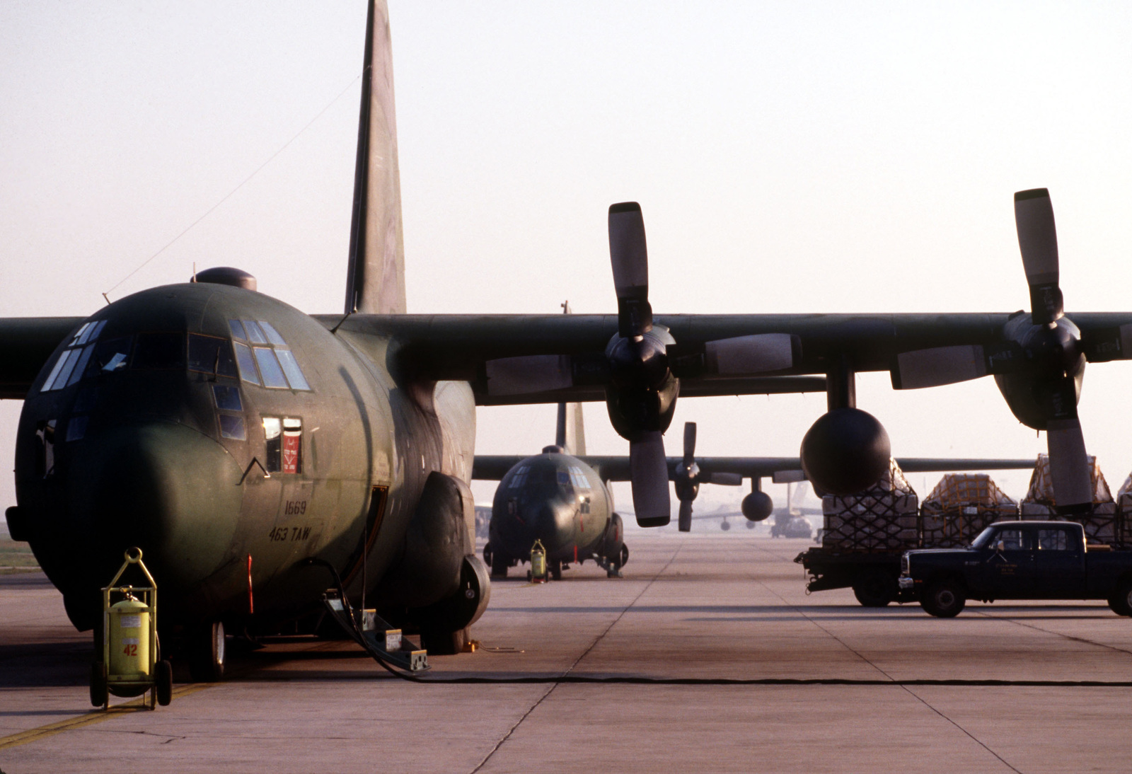 A C-130E Hercules aircraft from the 463rd Tactical Airlift Wing is