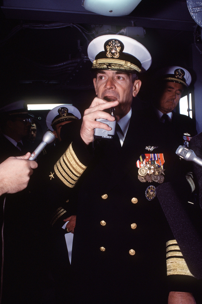 Vice CHIEF of Naval Operations ADM Jerome L. Johnson speaks during the decommissioning of the battleship USS IOWA (BB-61). Because of bad weather, the official party gathered on the IOWA's bridge and their remarks were broadcast throughout the ship. VADM Joseph S. Donnell III, Commander, Naval Surface Force, U.S. Atlantic Fleet, is at right