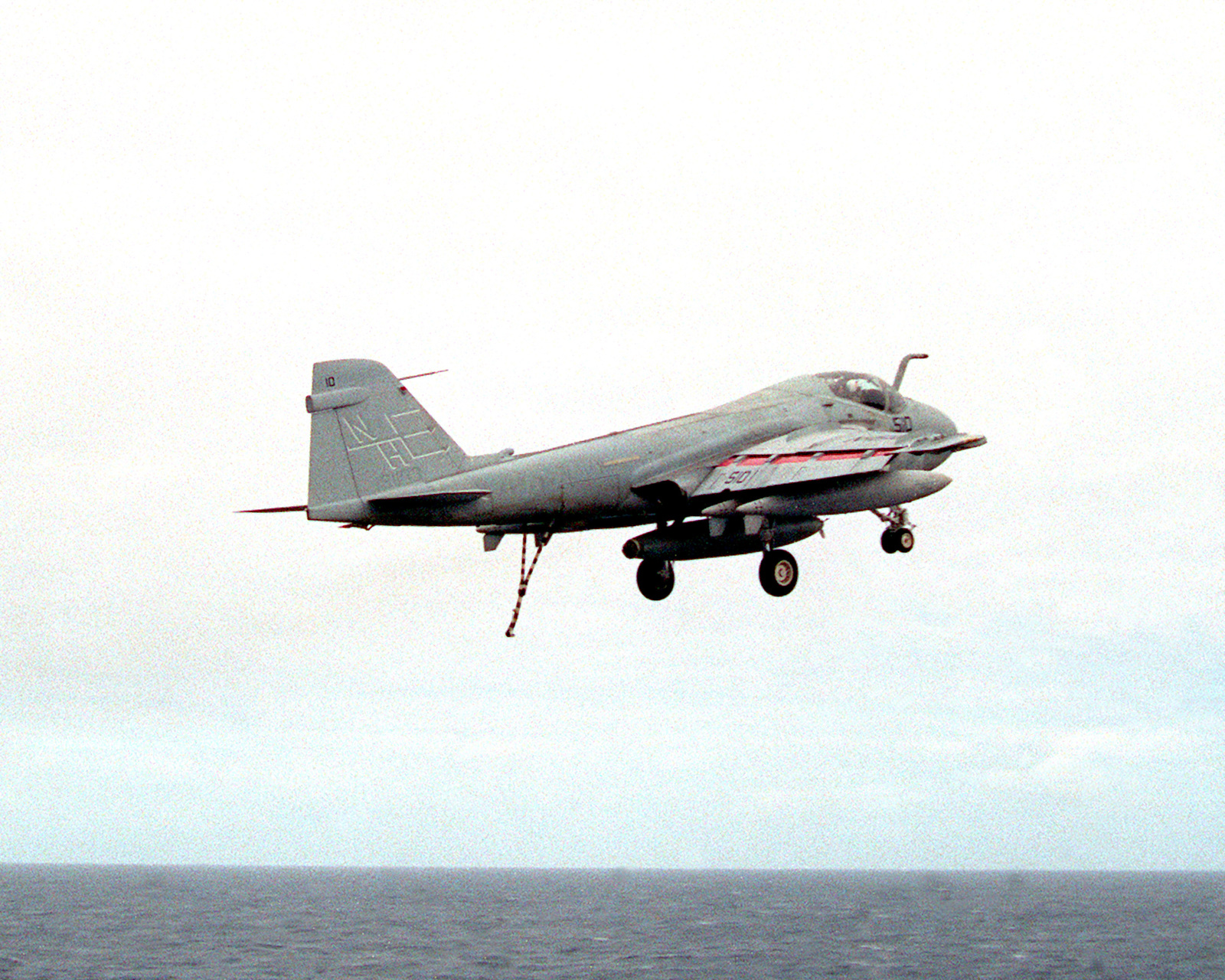 An Attack Squadron 95 (VA-95) A-6E Intruder aircraft gains altitude while flying off after missing the arresting wire on the flight deck of the nuclear-powered aircraft carrier USS ABRAHAM LINCOLN (CVN-72). The LINCOLN is underway during its circumnavigation of South America