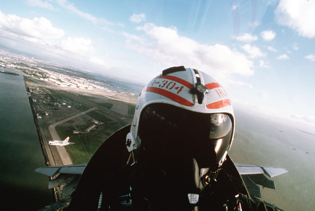 A view of the pilot of a Naval Air Reserve Attack Squadron 304 (VA-304) A-7E Corsair II aircraft as he flies his plane during a training mission