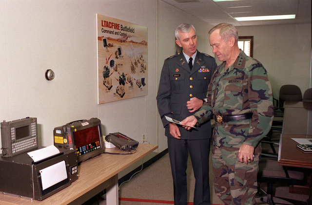 LTC Sheaves demonstrates the Lightweight Tactical Fire Direction Battlefield Command and Control System to LGEN Jerome B. Hilmes, Director of Information Systems for Command, Control, Communications, and Computer Systems