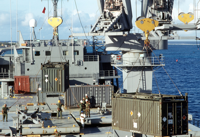 Containers of chemical munitions unloaded from the Military Sealift Command ship GOPHER SHIP (T-ACS-4) during Operation Steel Box. The munitions will be taken to the U.S. Army Chemical Activity on the atoll for storage and disposal
