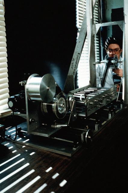 Bob Morris uses a fiber-spreading apparatus to prepare graphite fibers in the Metal Matrix Composite Integration Facility at the Naval Research Laboratory (NRL)
