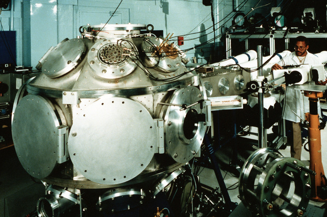 Levi Daniels adjusts the streak camera in the target facility for the Pharos III laser at the Naval Research Laboratory (NRL). During operations, laser beams are reflected off of mirrors located on a space frame and focused into the target chamber