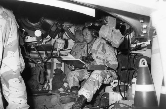 The crew of an R Battery, 5th Battalion, 11th Marine Regiment, 1ST Marine Division, 155mm M-109A1, 155mm self-propelled howitzer prepares for a fire mission during Operation Desert Shield
