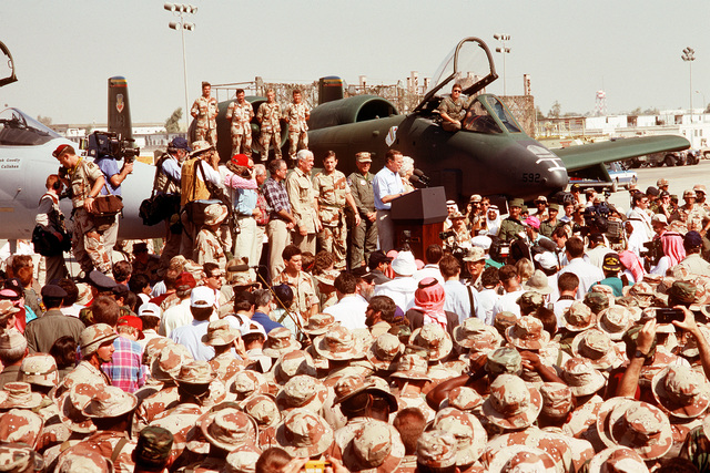 President George Bush speaks to U.S. Military personnel gathered for his Thansgiving holiday visit during Operation Desert Storm