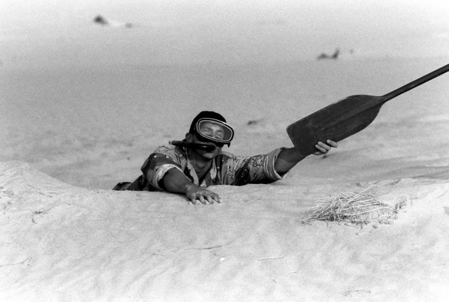 Marines from Company A, 1ST Reconnaissance Battalion, clowns while taking part in a training exercise during Operation Desert Shield.