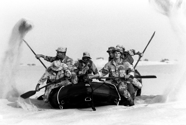 Marines from Company A, 1ST Reconnaissance Battalion, practice rowing in a raft while taking part in a training exercise during Operation Desert Shield.