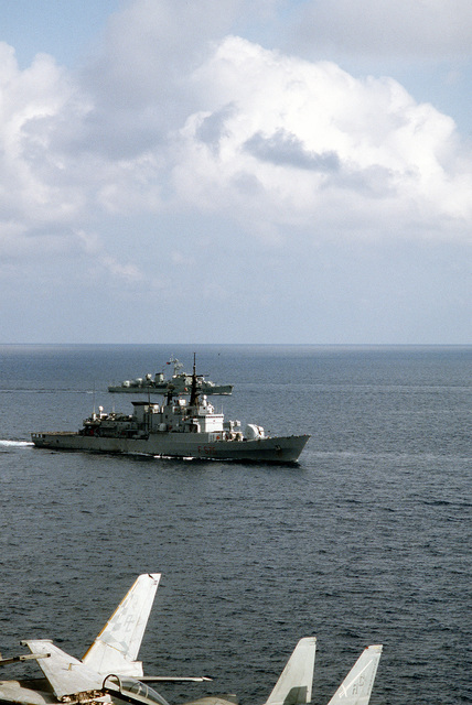A starboard bow view of the Italian frigate EURO (FF-575) and the Portuguese frigate NRP ALVARES CABRAL (FF-483) moving into formation near the aircraft carrier USS JOHN F. KENNEDY (CV-67) during exercise Deterrent Force 2/90, a part of Operation Desert Shield