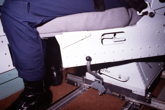 A closeup view of control mechanisms on the Model 1101 missile crew member chair, developed by AMI Industries. The chair is situated at a control inside a Minuteman III intercontinental ballistic missile silo