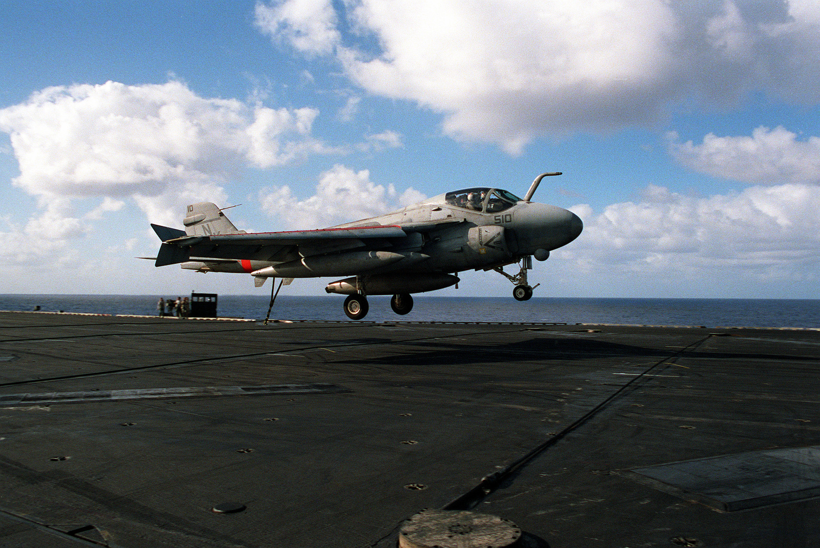 An A-6E Intruder aircraft prepares to catch the arresting wire on the flight deck of the aircraft carrier USS INDEPENDENCE (CV-62) as the vessel returns to the United States after serving in the Persian Gulf region during Operation Desert Shield