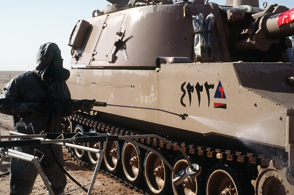 An Egyptian soldier decontaminates an M-109 155mm self-propelled howitzer of the Egyptian army's 3rd Armored Brigade during a field demonstration, part of Operation Desert Shield.