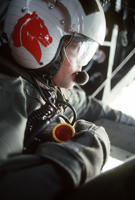 Aviation Machinist's Mate/AIRMAN J. Gudino monitors the sonar device trailing from a Helicopter Mine Countermeasures Squadron 14 (HM-14) MH-53E Sea Dragon helicopter during operations off the coast of Abu Dhabi, United Arab Emirates. The unit is using the AQS-14 minehunting system to locate inert mines planted by U.S. forces as part of a minehunting exercise during Operation Desert Shield
