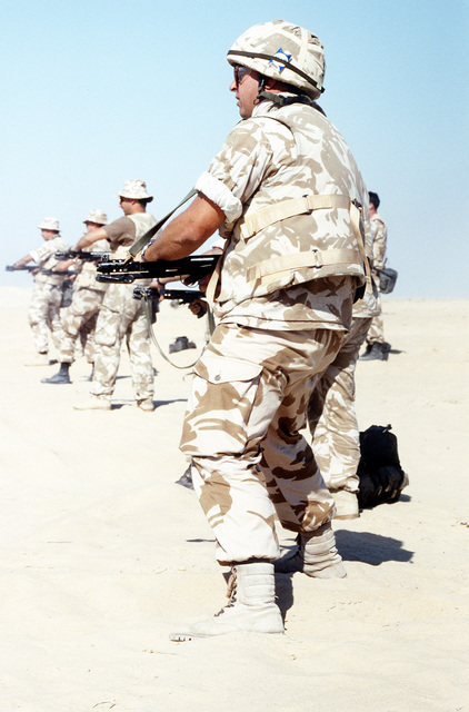 British soldiers from the Queen's Dragoon Guards fire their L2A3 Stelring submachine guns while conducting weapons training at Abu Hydra Range during Operation Desert Storm