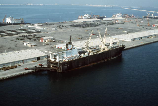 The vehicle cargo ship SGT. WILLIAM R. BUTTON (T-AK-3012) offloads cargo during Operation Desert Shield. The vessel is part of Maritime Pre-positioning Squadron 1.