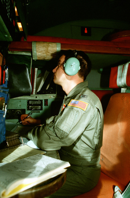 CPT Mel Soterlund, navigator, 374th Tactical Airlift Wing, makes calculations as he guides his C-130 Hercules aircraft toward a Micronesian island during a Christmas Drop mission. The annual airdrop is a humanitarian effort providing aid to needy islanders throughout Micronesia during the holiday season