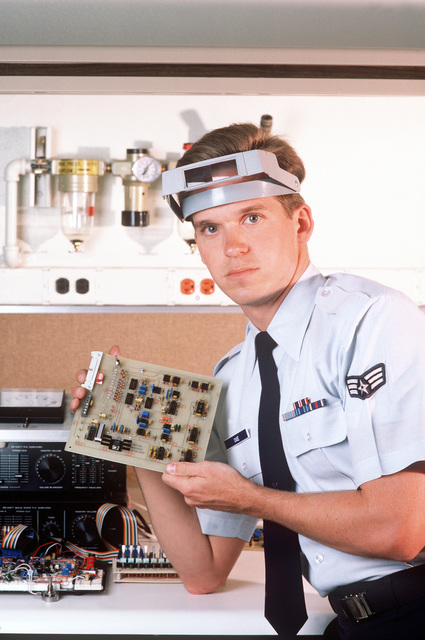 SGT James Case displays a circuit board from a computer-driven sound effects system used in driver training. Case is assigned to the Tactical Air Command's Training Systems Center
