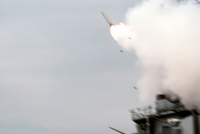 A BGM-109 Tomahawk land-attack missile heads toward an Iraqi target after being launched from a Mark 143 armored box launcher (ABL) aboard the battleship USS WISCONSIN (BB-64) during Operation Desert Storm