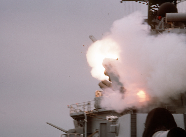 A BGM-109 Tomahawk land-attack missile (TLAN) is launched from a Mark 143 armored box launcher (ABL) aboard the battleship USS WISCONSIN (BB-64) during Operation Desert Storm