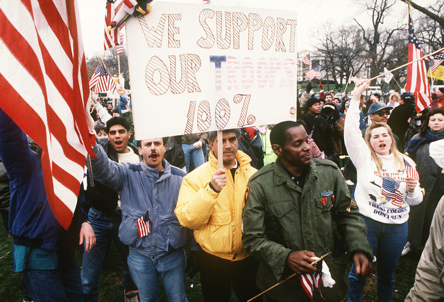 A crowd marches near the White House to show their support for Operation Desert Storm