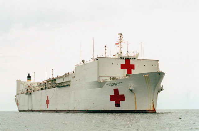 A starboard bow view of the hospital ship USNS COMFORT (T-AH-20). The vessel is deployed to the Persian Gulf during Operation Desert Storm
