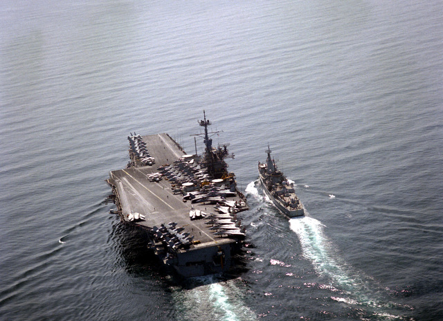 A stern view of the aircraft carrier USS RANGER (CV-61) conducting an underway replenishment of the Dutch frigate Hr Ms Jacob Van Heemskerck (F-812) during Operations Desert Shield/Storm