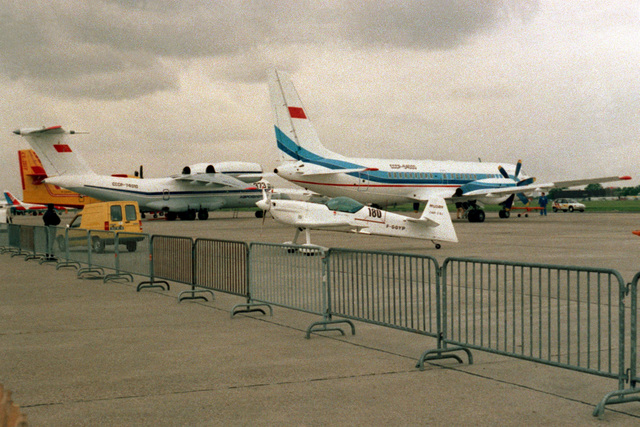 A view of some of the aircraft on display at the 1991 Paris Air Show, including a Soviet I1-114 twin-turboprop aircraft in the center background.