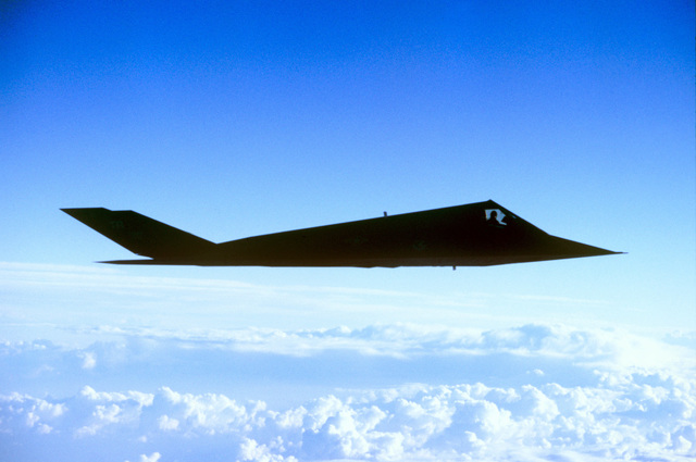 Air to air side view of a F-117 Nighthawk Stealth fighter during a training mission. Exact Date Shot Unknown