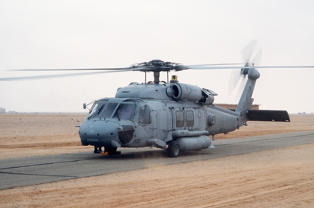 An HH-60H Sea Hawk helicopter from Helicopter Combat Search and Rescue/Special Warfare Support Squadron 4 (HCS-4) of Norfolk, Va., is prepared for a search and rescue mission at the start of Operation Desert Storm.