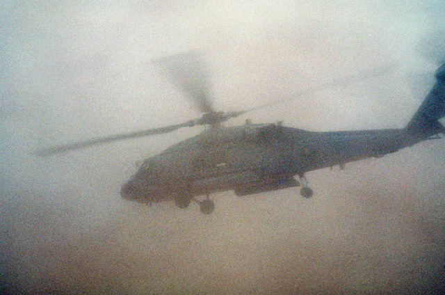 An HH-60H Sea Hawk helicopter from Helicopter Combat Search and Rescue/Special Warfare Support Squadron 4 (HCS-4) of Norfolk, Va., takes off in the sand for a search and rescue mission at the start of Operation Desert Storm.