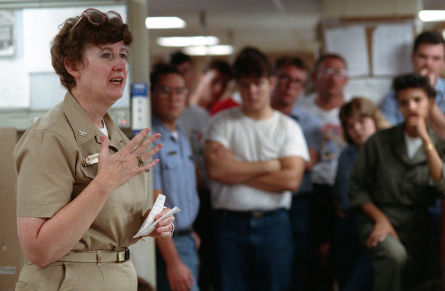 An officer instructs medical personnel aboard the hospital ship USNS COMFORT (T-AH-20) while the vessel is deployed to the Persian Gulf during Operation Desert Storm