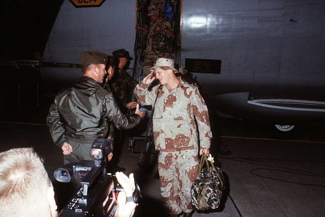 COL. C.O. Hoelle, commanding officer, Marine Corps Air Station, Beaufort, S.C., welcomes home a Marine returning from Operation Desert Storm