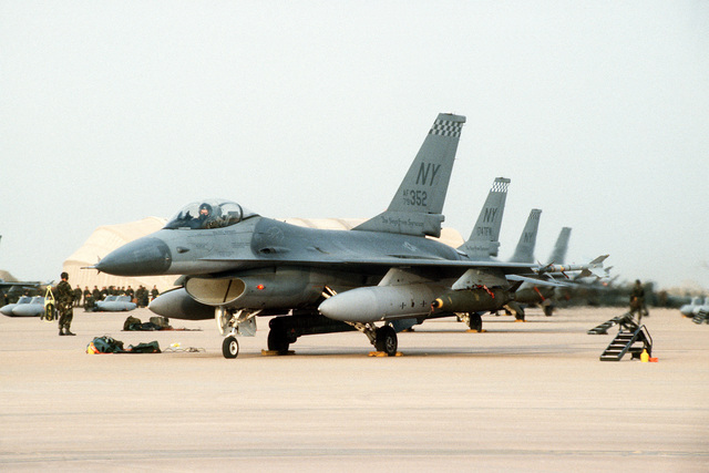 F-16A Flight Falcon fighter aircraft from the Air National Guard's 174th Tactical Fighter Wing, Hancock Field, N.Y., armed with Mark 84 2,000-pound bombs, stand ready for a mission at the start of Operation Desert Storm.