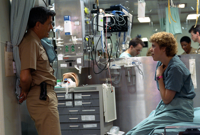 Medical personnel confer aboard the hospital ship USNS COMFORT (T-AH-20) as the vessel is deployed to the Persian Gulf during Operation Desert Storm