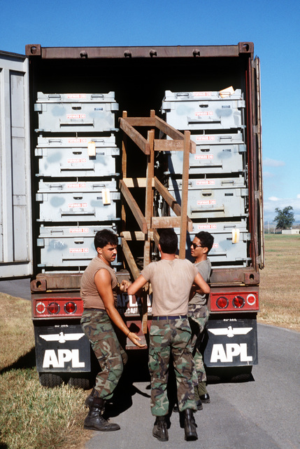 Members of the 3rd Equipment Maintenance Squadron place blocking and bracing materials between cases of Mark 20 anti-tank bombs on a truck for shipment to Operation Desert Storm. They are, from left to right: AIRMAN 1ST Class Rob Pila, AIRMAN Anthony Ellis and SENIOR AIRMAN Dave Alberto