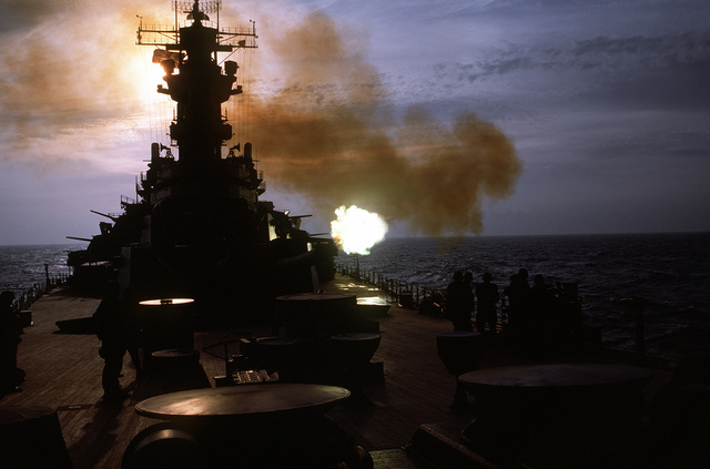 One of the Mark 38 5-inch/38-caliber guns aboard the battleship USS WISCONSIN (BB-64) is fired during Operation Desert Storm