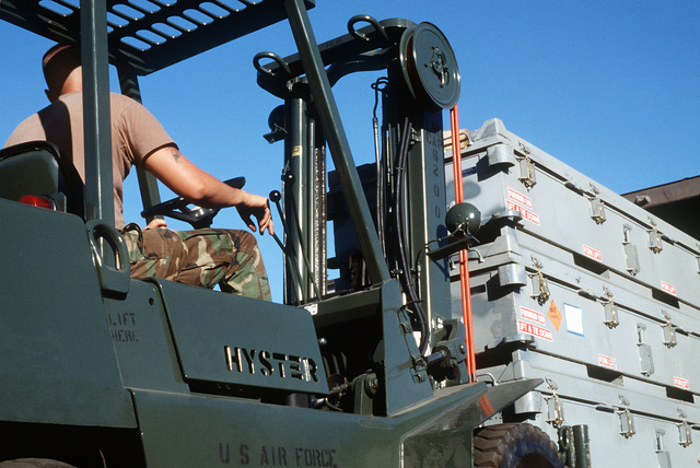 SENIOR AIRMAN Brian Robinson from the 3rd Equipment Maintenance Squadron prepares to load cases of Mark 20 anti-tank bombs onto a truck for shipment to Operation Desert Storm
