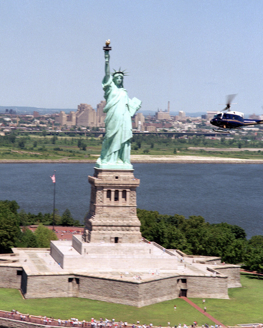 The UH-IN Iroquois helicopter used to transport the Secretary of the Air Force flies near the Statue of Liberty. The helicopter is assigned to the 1ST Helicopter Squadron. (Substandard image)