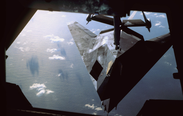 View from a KC-10 tanker as of a F-117 Nighthawk Stealth fighter is refueled inflight. Exact Date Shot Unknown