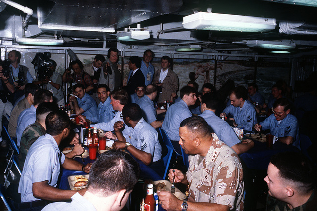 Crew members from his home state of Indiana enjoy breakfast with Vice President J. Danforth Quayle aboard the aircraft carrier USS JOHN F. KENNEDY (CV-67). LT. GEN. Calvin A.H. Waller, foreground, is also taking part in the gathering. Quayle is aboard the ship as part of a three-day visit with military forces deployed to the Middle East in support of Operation Desert Shield